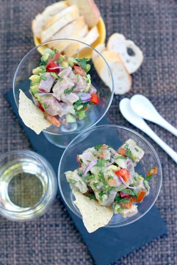 Ahi Tuna Ceviche in a serving dish with a glass of wine