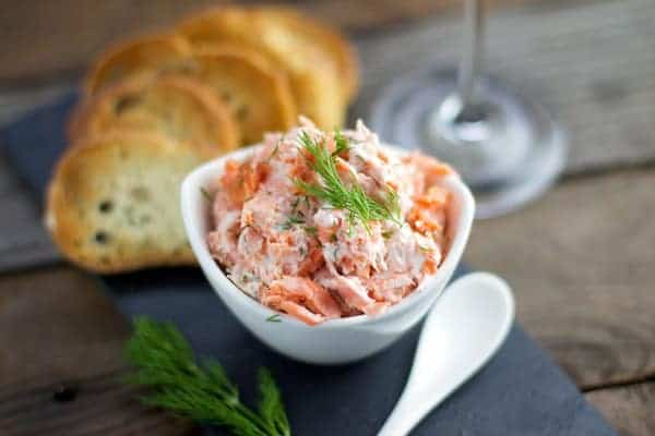 Smoked Salmon Dip in a white bowl garnished with dill