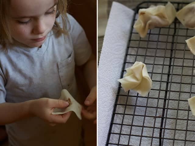 Kids helping to wrap wontons