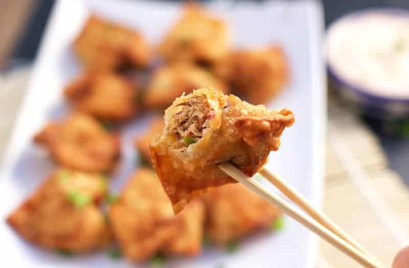 Smoked Pulled Pork Fried Wonton being held with chop sticks