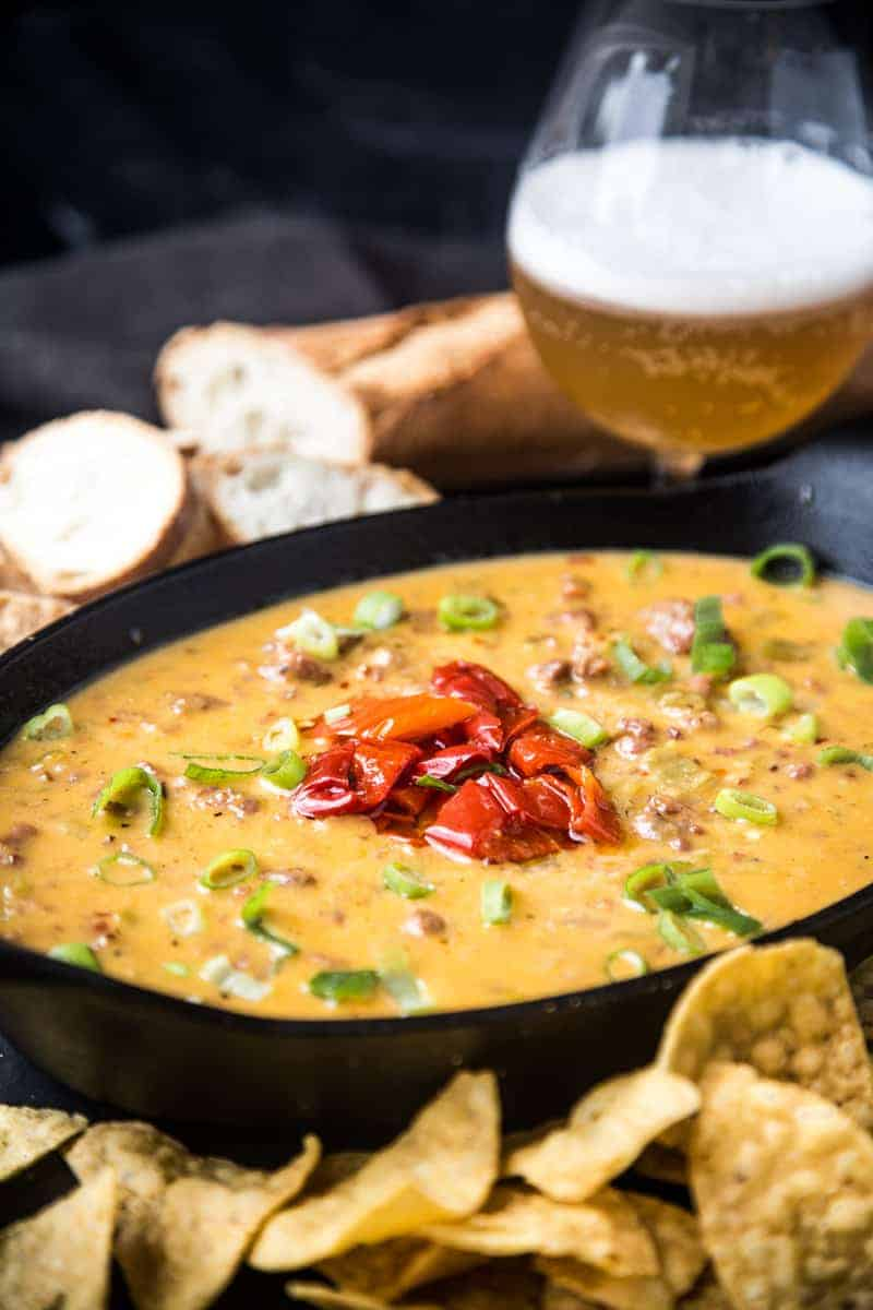 Smoked Sausage and Hatch Chili Beer Cheese Dip in a black bowl