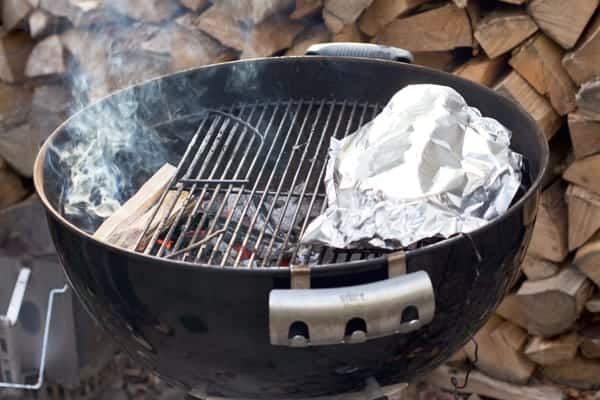 Cooking an apple crisp on an outdoor grill