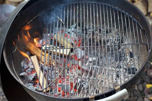 Where to put wood chips on a charcoal grill to maximize smoke flavor without a smoker.