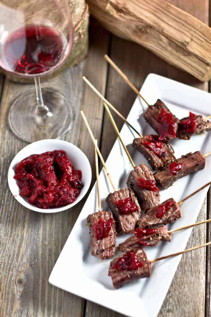 Marinated Steak Skewers. An easy appetizer filled with savory flavors, a touch of holiday sweetness, a small bit of spice, a good dose of protein, and they won't weigh you down.