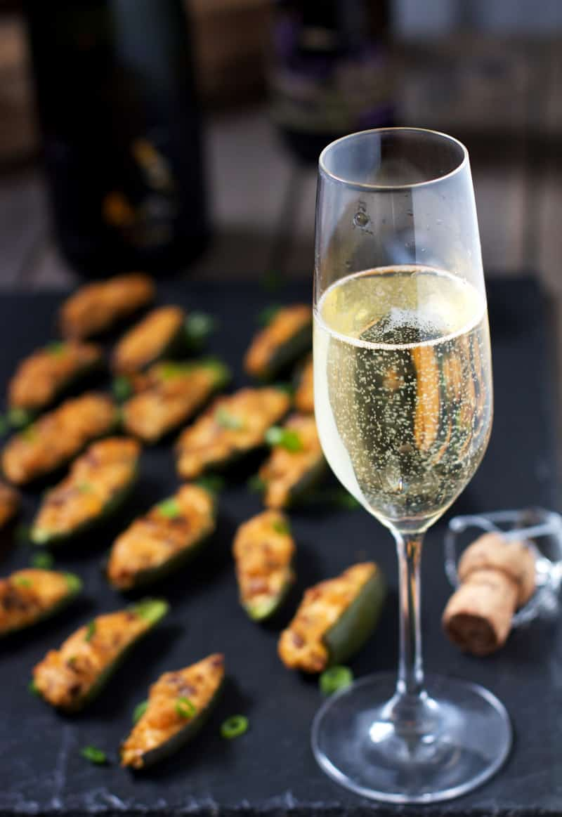 A glass of sparkling wine to pair with Super Bowl appetizers