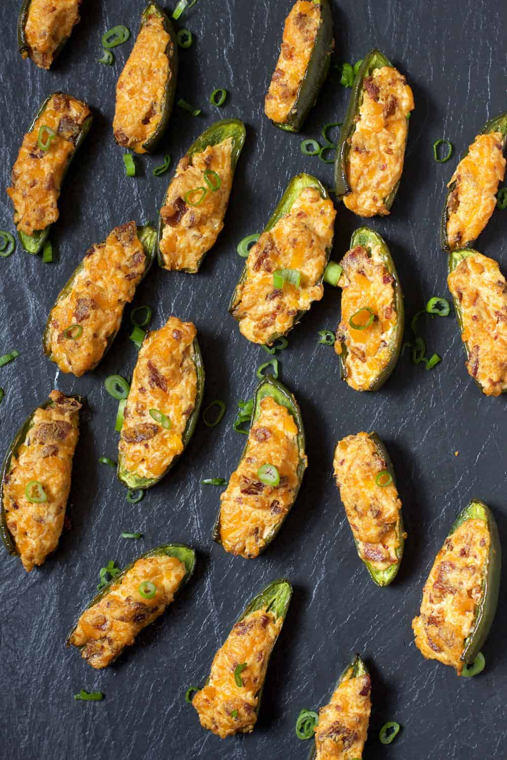 Smoked Jalapeno Poppers on a black slate board