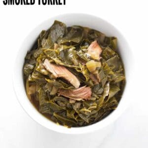 collard greens with smoked turkey leg in a bowl, pinterest text