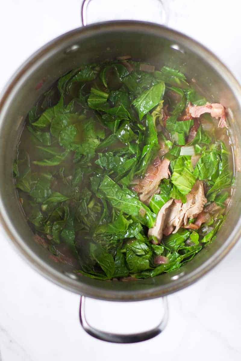 Making Collard Greens with homemade Smoked Turkey Leg