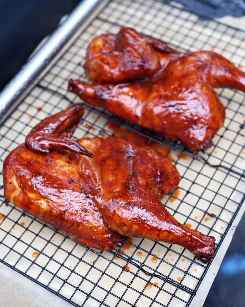 Dry Brined Smoked Chicken with a Carolina BBQ Glazed on a cooling rack