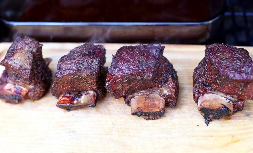 Smoked beef short ribs on cutting board