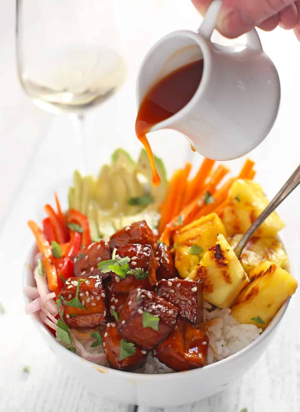BBQ Tofu Bowls being drizzled with bbq sauce