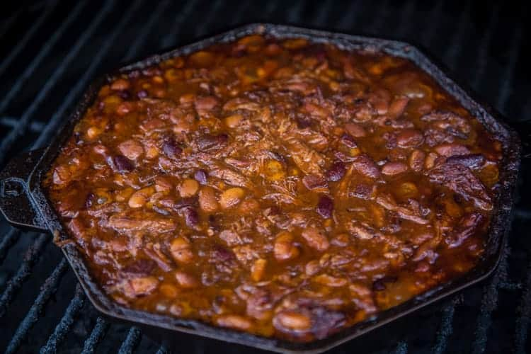 Cooking barbecued baked beans on the grill