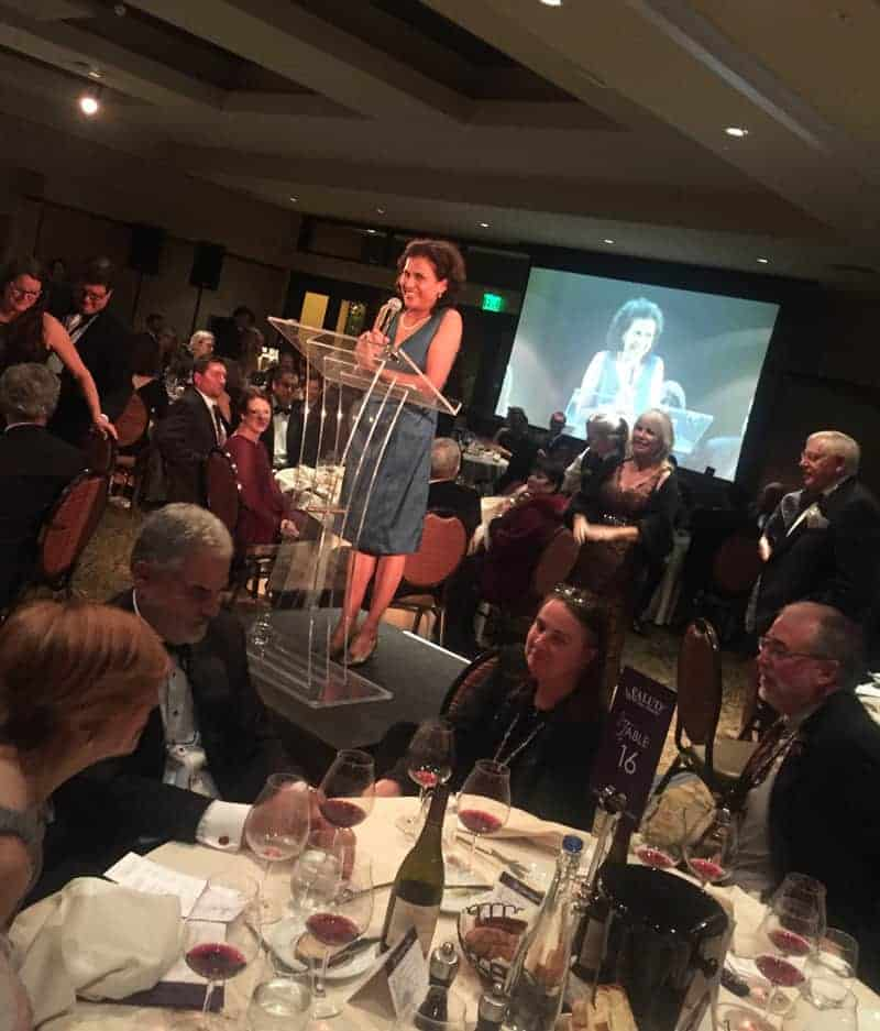 Leda Garside speaking at 2015 ¡Salud! Auction