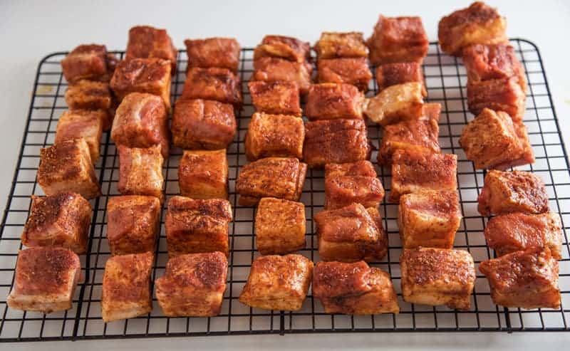 Cubes of raw Pork Belly coated with dry rub