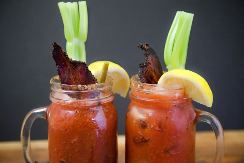 Two mason jars filled with Smoked Bloody Mary Cocktails