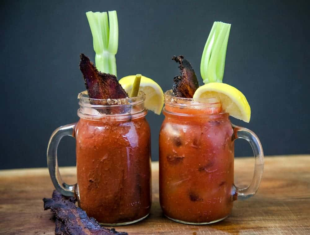Two glasses of Smoked Bloody Marys with Smoked Bacon