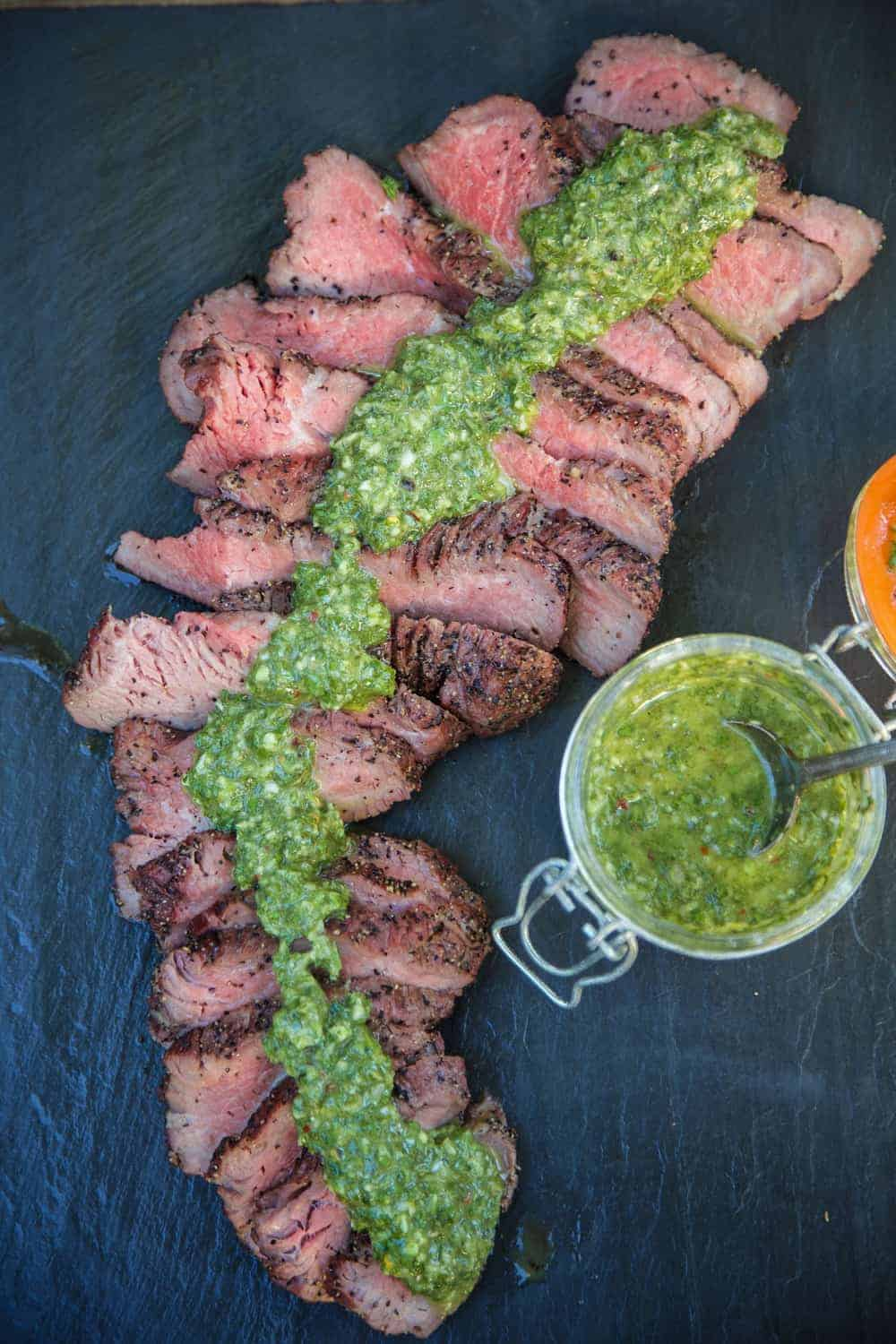 Slices of Red Wine Marinated Smoked Tri Tip with Chimichurri Sauce