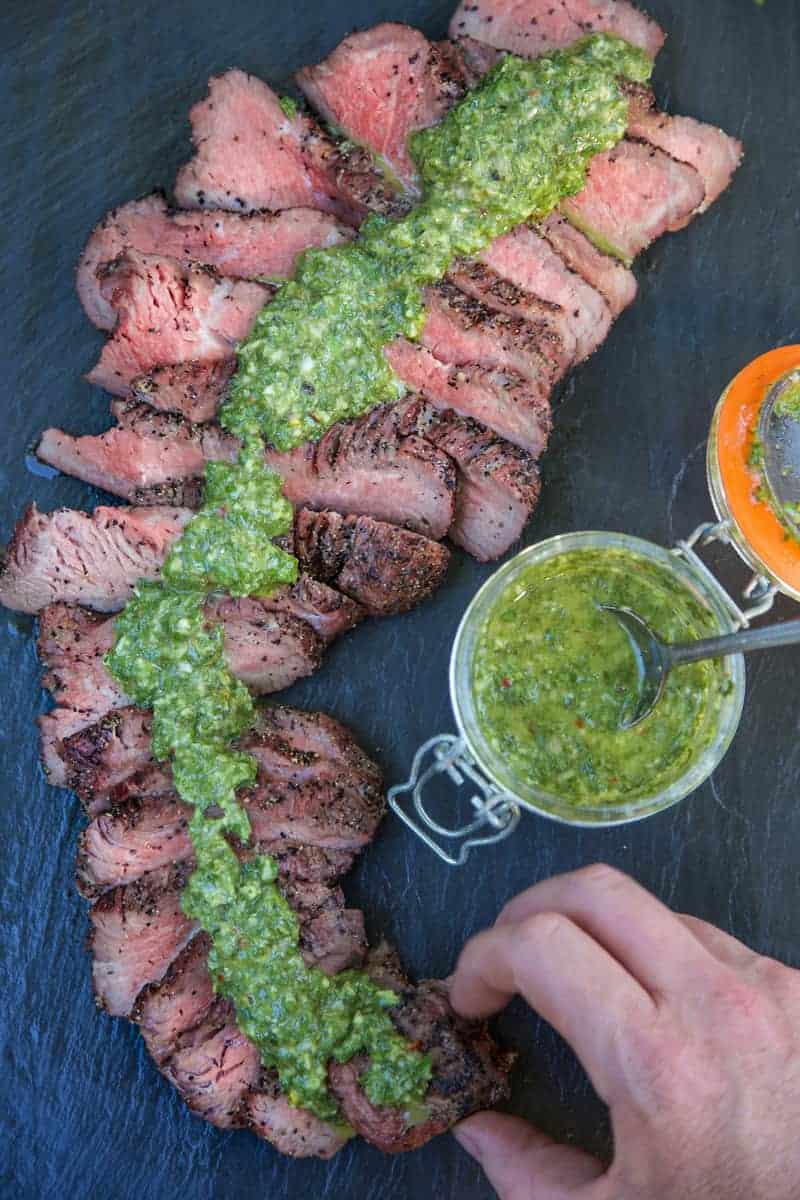 Smoked Tri Tip with Chimichurri Sauce, digging in