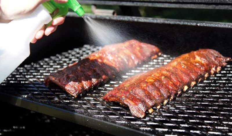 When to sprits ribs on the smoker