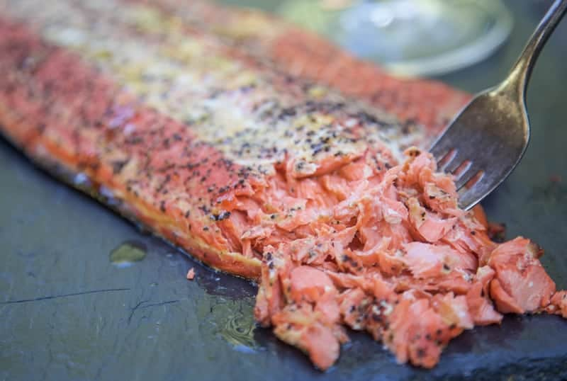 smoked salmon being flaked with a fork