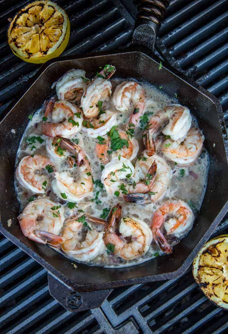 Cooking shrimp in garlic wine butter sauce on the grill