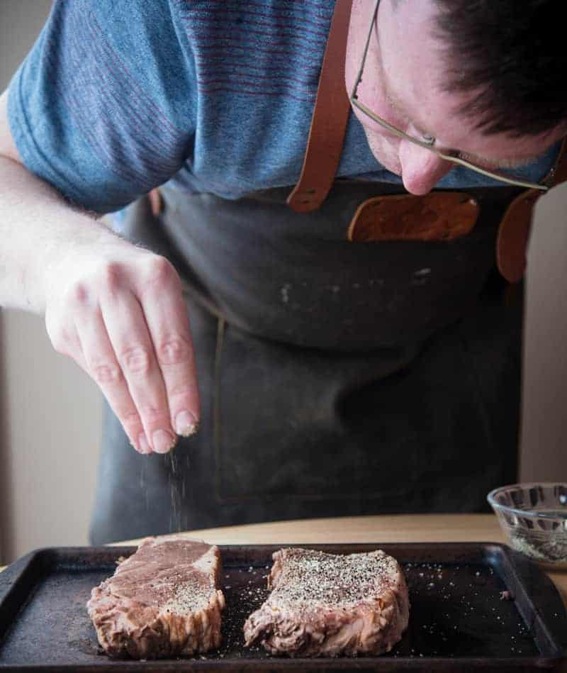 Applying Dry Rub to New York Strip Steak
