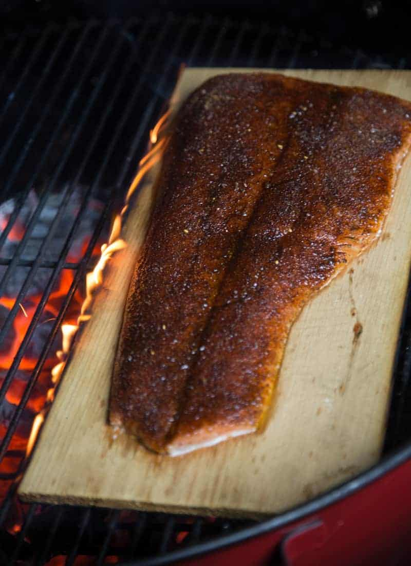 Cedar plank salmon over direct heat with a little flame to the side