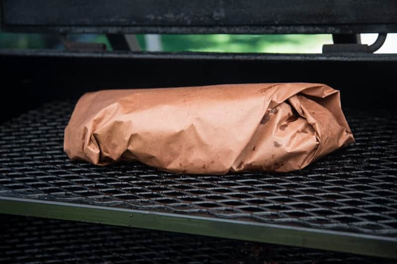 Brisket wrapped in pink butcher paper
