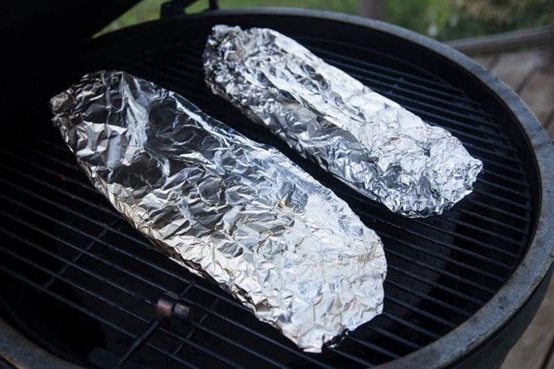 Meat wrapped in foil on the grill