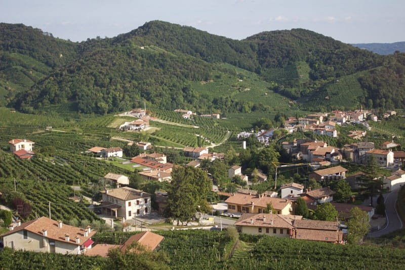 Village of Cartizze in Italy with hillside.
