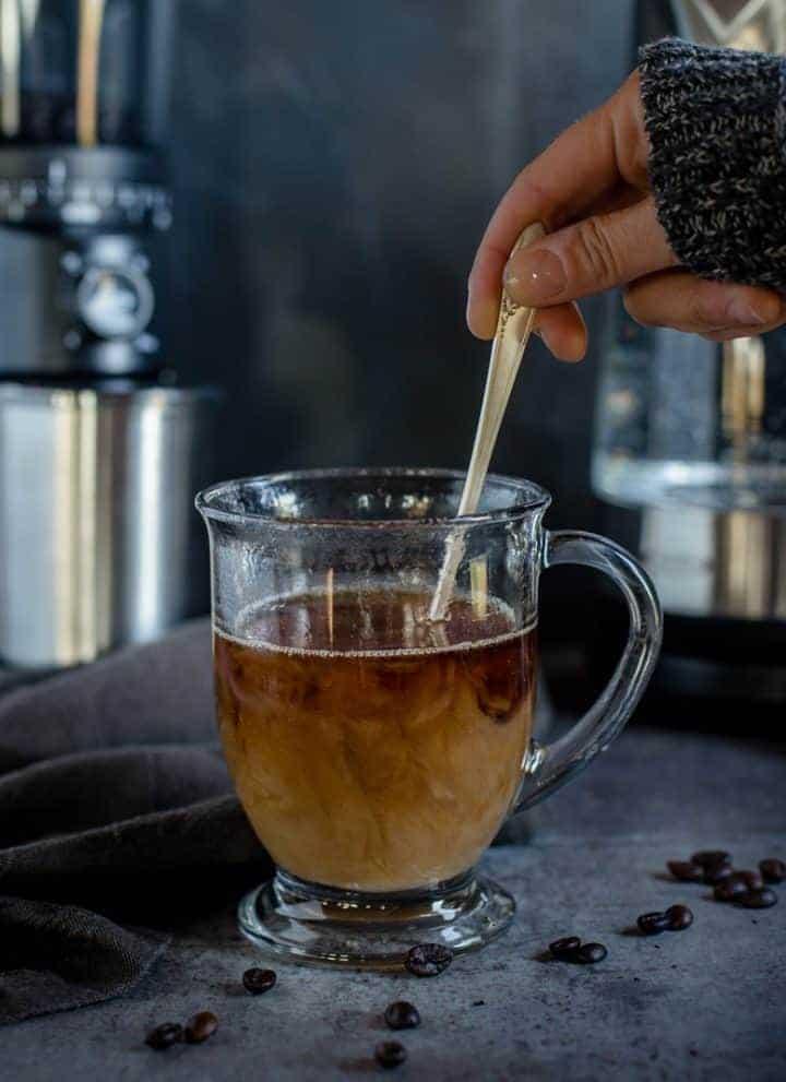 Stirring Coffee with Cream