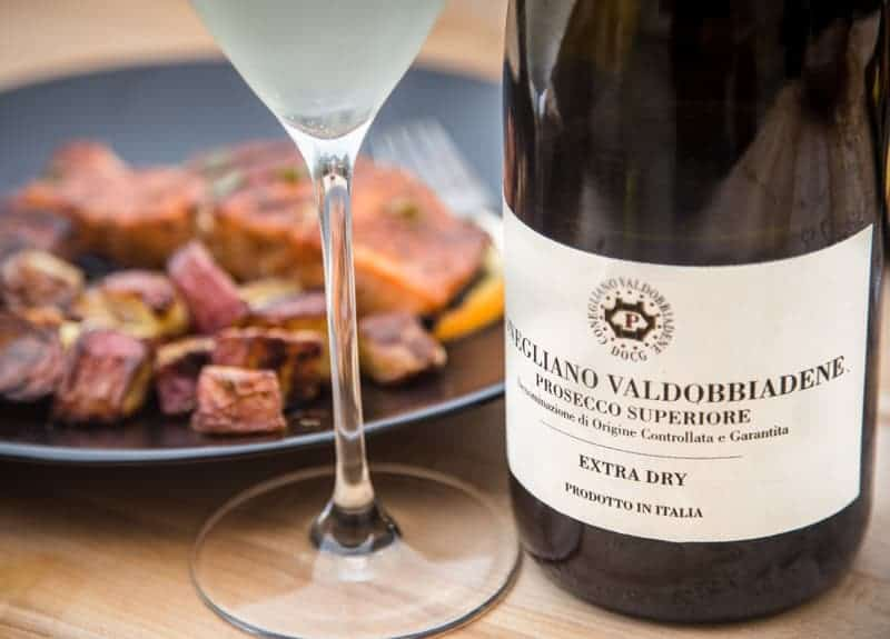 Prosecco Superiore DOCG with grilled salmon recipe and glass of wine.