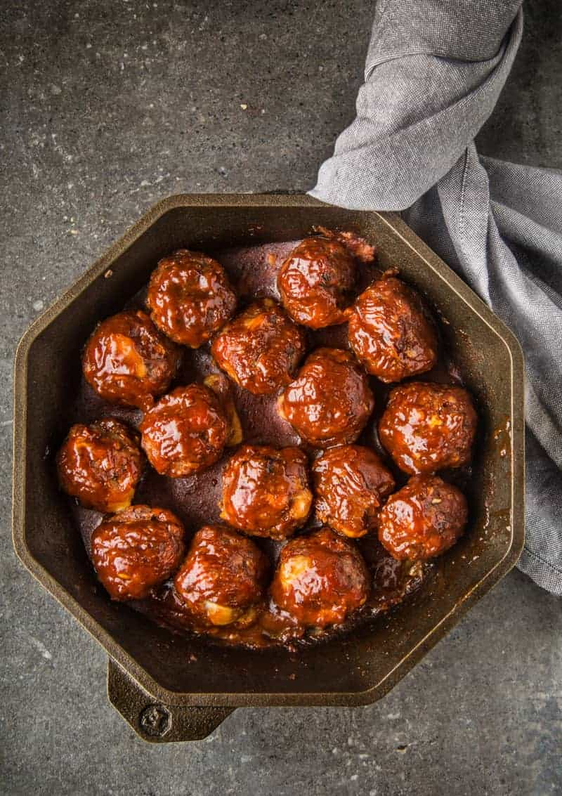 Cheese Stuffed Smoked Meatballs with BBQ Glaze in a FINEX cast iron pan