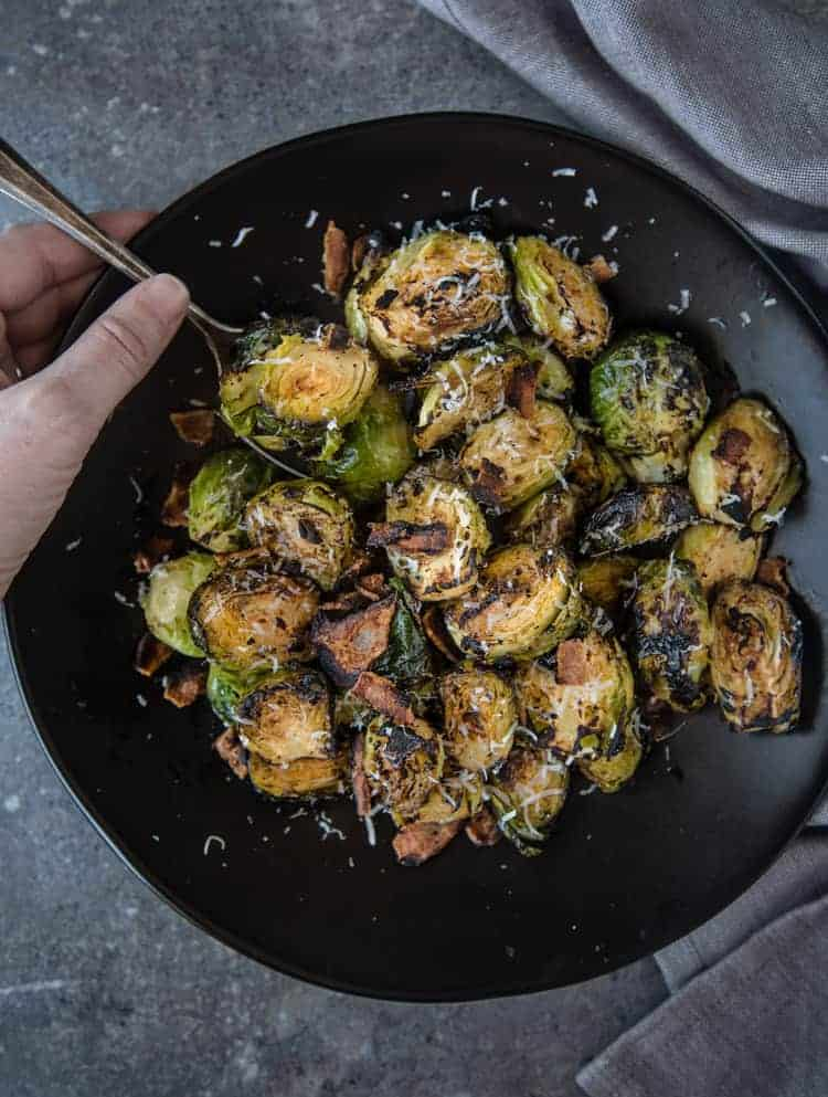 Grilled Brussels sprouts with bacon and balsamic in a serving bowl