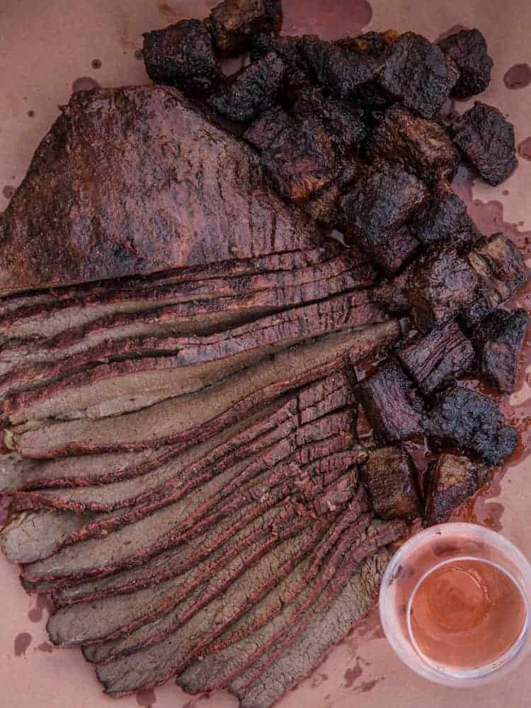 Burnt ends and brisket flat slices on a serving tray.