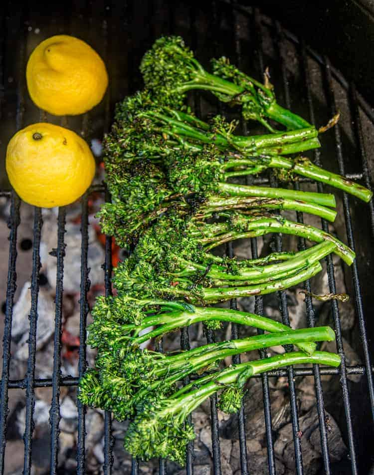 Cooking broccolini and lemon on the grill