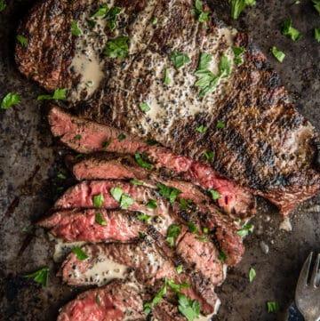 Grilled Bavette Steak sliced thin on a cutting board