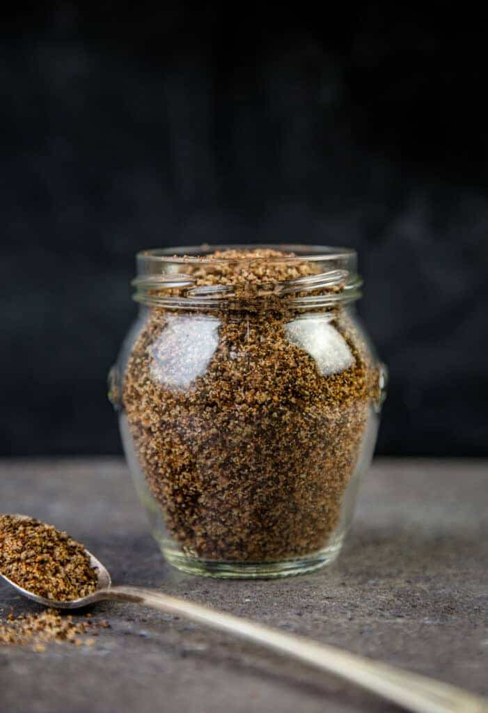 Coffee and Ancho Chili dry rub for Steaks in a glass jar.