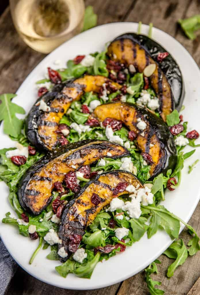 Grilled Acorn Squash over a bed of arugula.