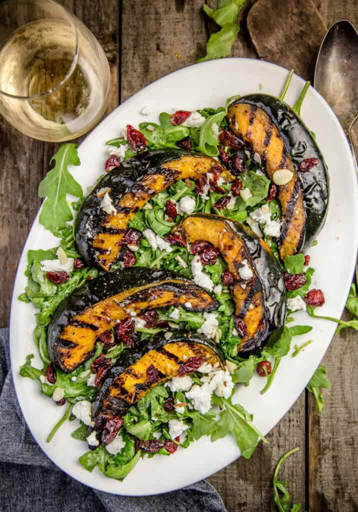 Grilled Acorn Squash Salad tossed with arugula and a citrus vinaigrette.