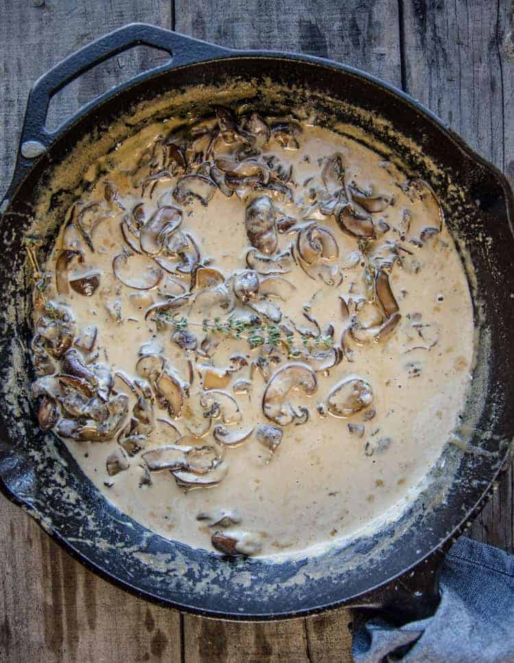 Mushroom Cream sauce in a cast iron pan.