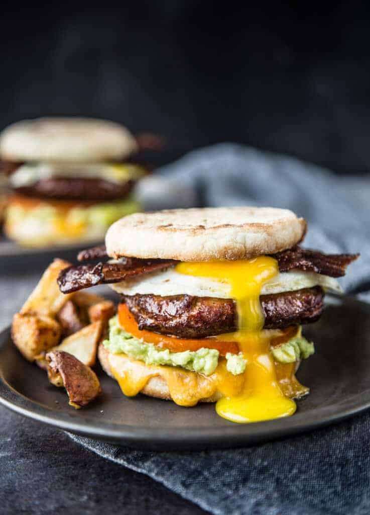 Two Breakfast Sandwiches with Smoked Sausage and Bacon