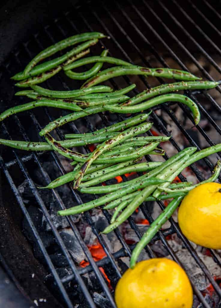 Fresh Green Beans and lemon halves on the grill