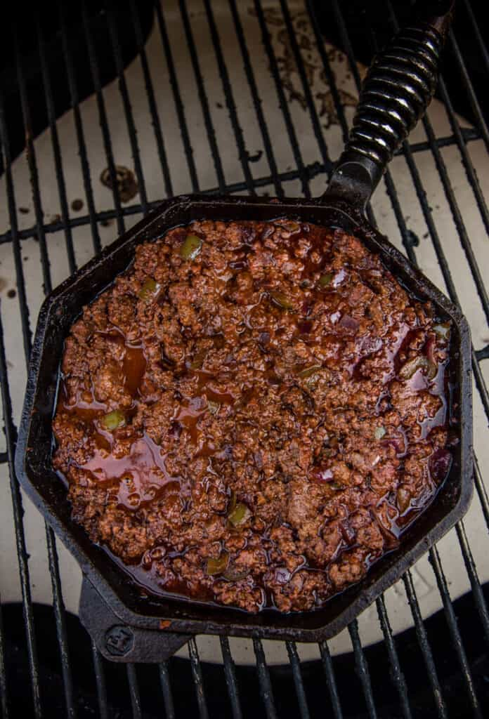 Sloppy Joe filling in a cast iron skillet in a smoker