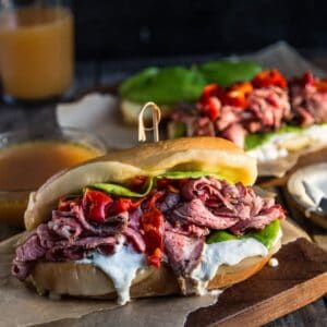 French Dip Sandwiches on a cutting board with homemade au jus sauce