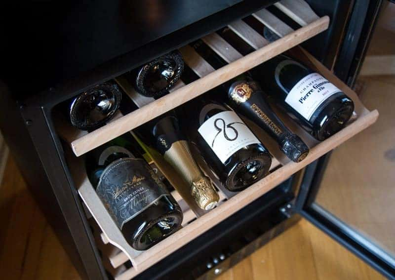 NewAir 24 inch wine cooler with beech wood storage racks. Holds alternating bottles.