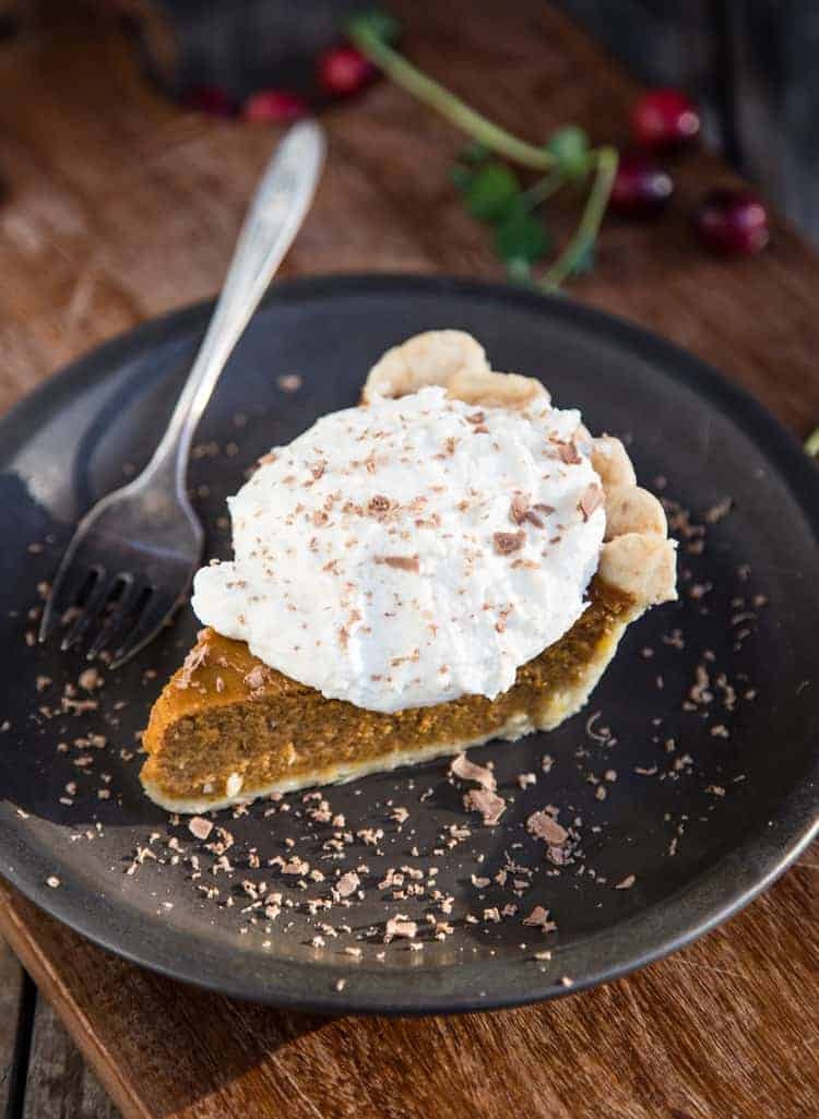Smoked Whipped Cream on top of a slice of pumpkin pie