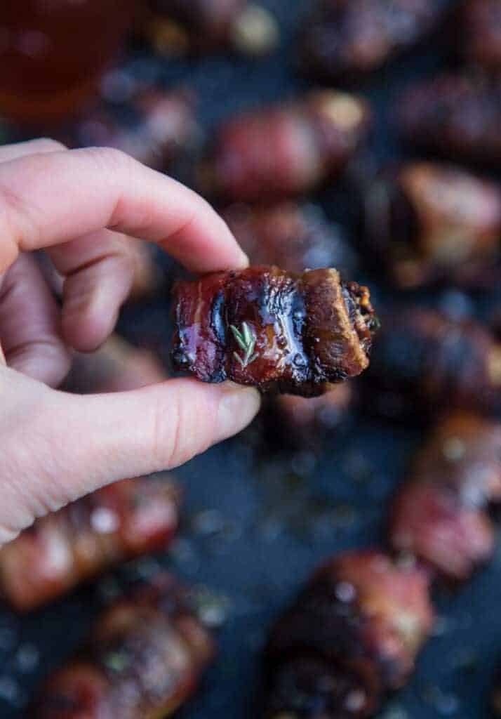 A single bite size Grilled Bacon Wrapped Date appetizer