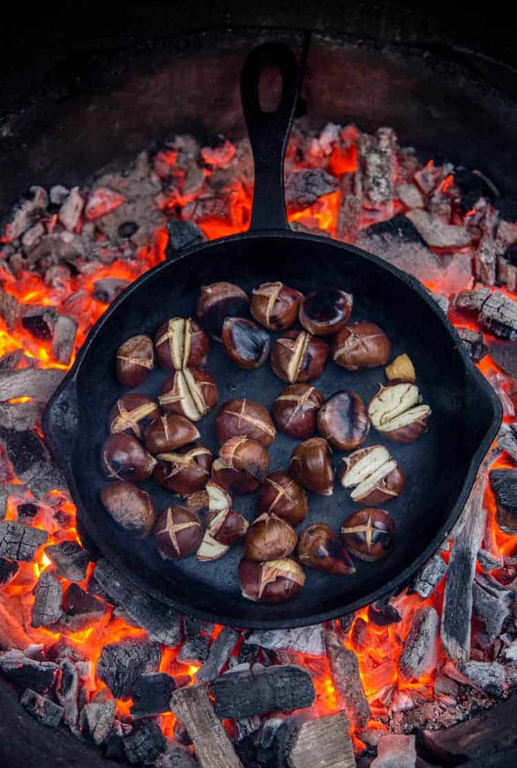 Roasting Chestnuts on an open fire in a cast iron pan