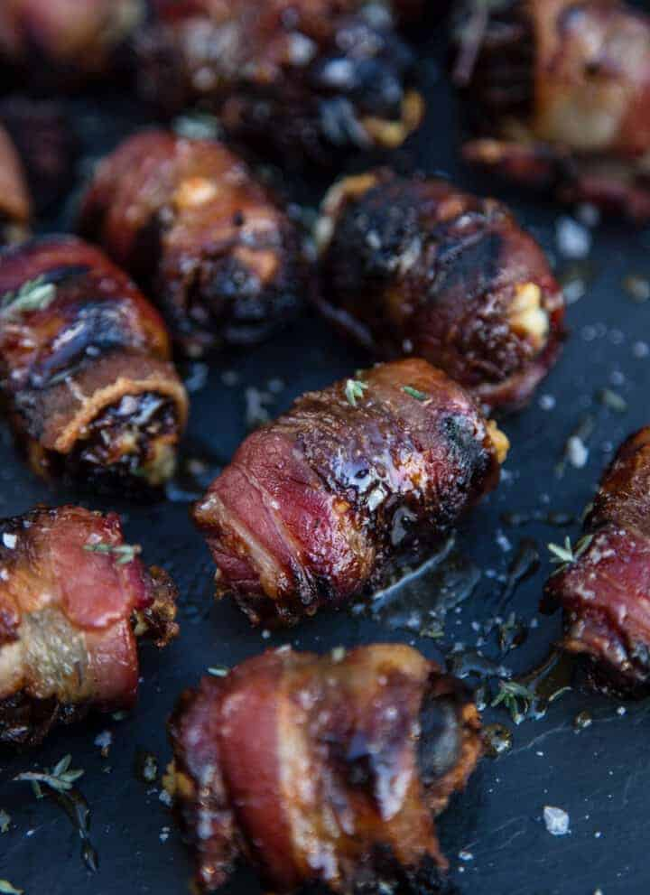 Grilled Bacon Wrapped Stuffed Dates on a platter